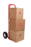 A red hand truck on white with boxes royalty free stock photography