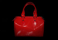 Red handbag. An isolated red handbag,made of leather,on a black background Stock Photos