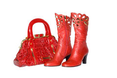 Red handbag and boots. The red handbag and boots is photographed on a white background Stock Photos