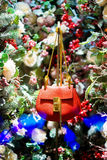 Red handbag in Christmas tree, snow and decorations. Snow and decorations and red handbag in Christmas tree Royalty Free Stock Photos