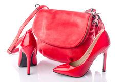 Red handbag and high heel shoes. Isolated on white royalty free stock photography
