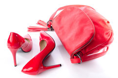 Red handbag and high heel shoes. Isolated on white stock images
