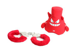 Red handcuffs and devil sex shop. Red devil with closed red handcuffs sex shop isolated on white background Stock Photography