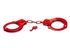 Red handcuffs isolated on white Stock Photography