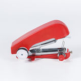Red handheld sewing machine isolated on white. Stock Photos
