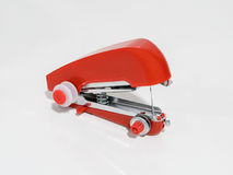 Red handheld sewing machine isolated on white Royalty Free Stock Photo