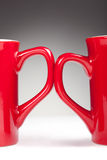 Red handle cups Stock Images