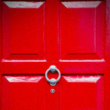 red handle in london antique brown door  rusty  brass nail and l Stock Image