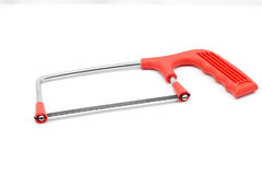Red handle saw. In white isolated background Royalty Free Stock Photos