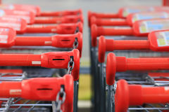Red handles of shopping trolleys Stock Image