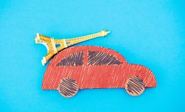 Red handmade car delivery with Eiffel tower souvenir stock image