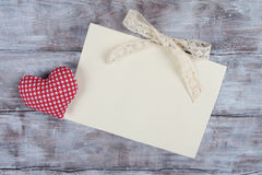 Red handmade heart and ragged paper sheet Royalty Free Stock Image
