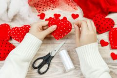 Red handmade heart-shaped soft toy, Valentine day, romantic relationship, healthy lifestyle, beautiful present, love and health ca Royalty Free Stock Photos