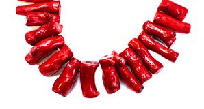 Red handmade natural coral necklace isolated on white. Color coral isolated on white background stock photo