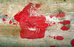 Red handprint. On wooden background Royalty Free Stock Photo