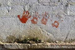 Red handprints on the wall Royalty Free Stock Photos