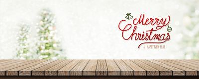 Red handwriting merry christmas and happy new year over wood tab stock images