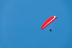 Red Hang Glider in a Deep Blue Sky Stock Images