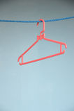 Red hangers Stock Images