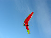 Red hangglider. Blue sky royalty free stock images