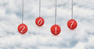 2017 in red hanging baubles against a composite image 3D of cloud. 2017 in red hanging baubles against a composite image 3D of white clouds Stock Images