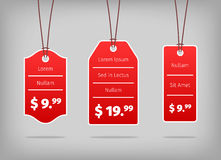 Red hanging pricing tags or labels with white Royalty Free Stock Photos