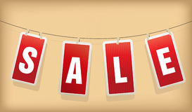 Red hanging sale labels. Stock Photo