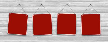 Red hanging signs on the wooden surface. Royalty Free Stock Image