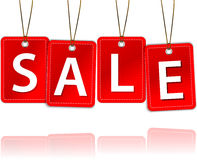 Red hanging tags with the word sale Stock Image