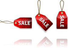 Red hanging tags with the word sale Stock Photography