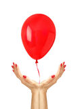 Red happy air flying ball fly from woman hands over white Royalty Free Stock Photos