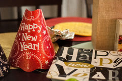 Red Happy New Year Party Hat and Black, White, and Gold Plate. New Years Celebration stock photography