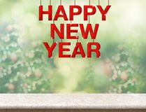 Red happy new year wood word hanging over marble table top with royalty free stock image