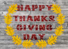 Red Happy Thanksgiving Day written on wooden board background. Close Stock Photos