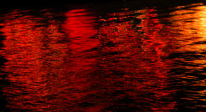 Red Harbor. The lights from boats decorated for a holiday boat parade reflect on the water in Channel Islands Harbor in Oxnard, California stock image
