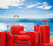 Red hard case luggages. 3d rendering red hard case luggages with summer background Royalty Free Stock Photography