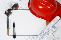 Red hard hat and blueprints Royalty Free Stock Photography
