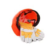 Red hard hat with leather gloves. Royalty Free Stock Photography