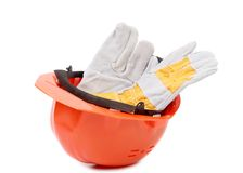 Red hard hat with leather gloves. Royalty Free Stock Images