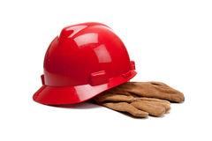 Red hard hat and leather work gloves on white Royalty Free Stock Photography