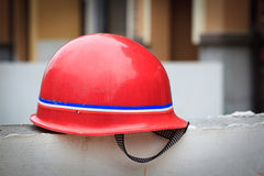 Red hard hat on a wall Royalty Free Stock Photo