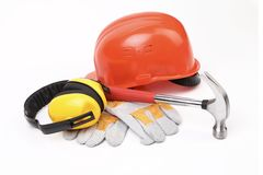 Red hard head gloves and tools Stock Photo