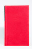 Red hardback book on white background Royalty Free Stock Photography