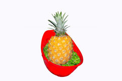 Red Hardhat with pineapple. Stock Photos