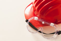 Red Hardhat and Protective Glasses Stock Photo