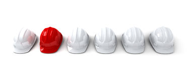 Red hardhat among white ones Stock Photography