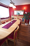Red hardwood dining room  Stock Images