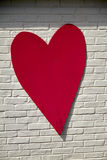 Red hart on wall Stock Photography