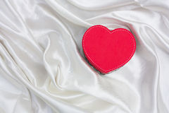 Red hart. On white cotton background royalty free stock image