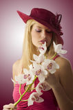 Red hat anf flowers Royalty Free Stock Images
